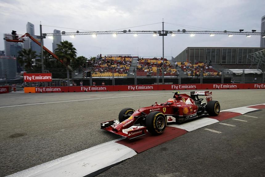 Ferrari Formula One driver Kimi Raikkonen of Finland drives during the third practice session of the Singapore Formula One Grand Prix at the Marina Bay street circuit in Singapore on Sept 20, 2014. -- PHOTO: REUTERS