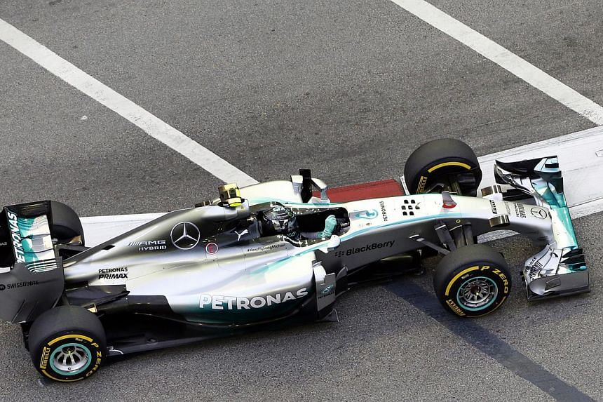Mercedes driver Nico Rosberg of Germany drives during the third practice session of the Formula One Singapore Grand Prix at the Marina Bay street circuit as seen from Swissotel The Stamford on Sept 20, 2014. -- ST PHOTO:CHEW SENG KIM