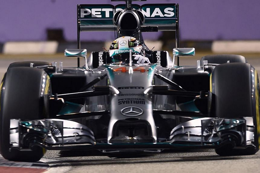 Mercedes driver Lewis Hamilton of Britain during the qualifying session of the Formula One Singapore Grand Prix at the Marina Bay Street circuit on Sept 20, 2014. -- PHOTO: AFP
