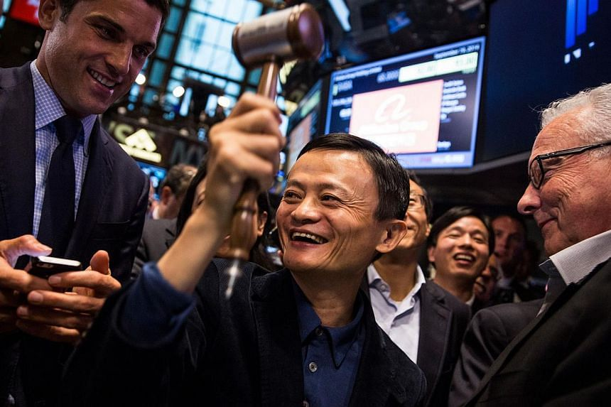 Founder and executive chairman of Alibaba Group Jack Ma celebrates as the Alibaba stock goes live during the company's initial public offering at the New York Stock Exchange on September 19, 2014 in New York City. Alibaba shares vaulted higher i