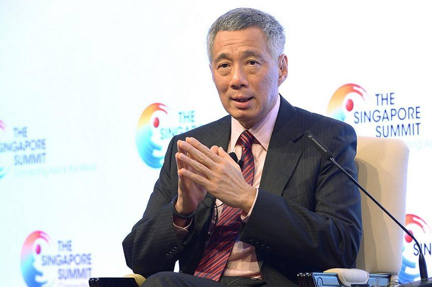 Singapore Prime Minister Lee Hsien Loong speaks during the Singapore Summit at the Singapore ShangriLa Hotel in Singapore on Sept 20, 2014.  -- ST PHOTO: NG SOR LUAN