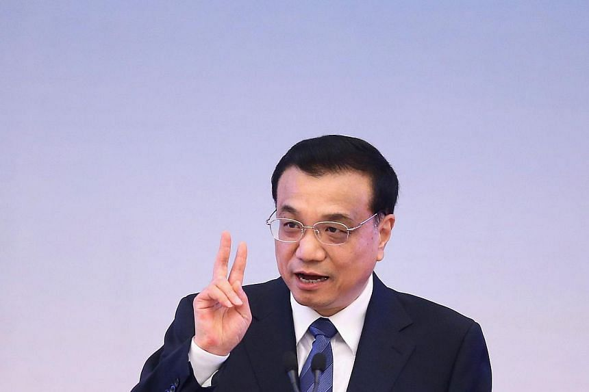 China will continue leading a prudent monetary policy with focus on targeted easing measures, Premier Li Keqiang said, according to a statement published on a central government website. -- PHOTO: AFP