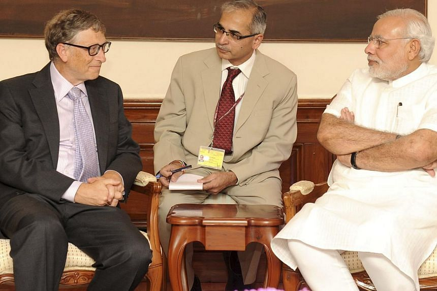 Microsoft's technology advisor Bill Gates (left) speaks with India's Prime Minister Narendra Modi (right) during their meeting in New Delhi on Sept 19, 2014. -- PHOTO: REUTERS