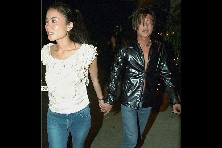A file photo of Faye Wong and Nicholas Tse leaving a party. Theyhave got back together, 11 years after they broke up and went on to marry and divorce other people, say Chinese and Hong Kong reports. -- PHOTO: APPLE DAILY