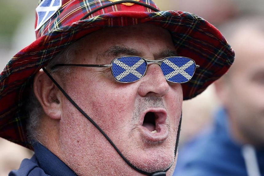 A supporter of Scottish independence makes his allegiance plain in Glasgow on Sept 19, 2014. -- PHOTO: REUTERS
