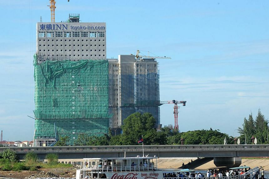 New buildings being constructed in Phnom Penh in August 2014. -- PHOTO: AFP