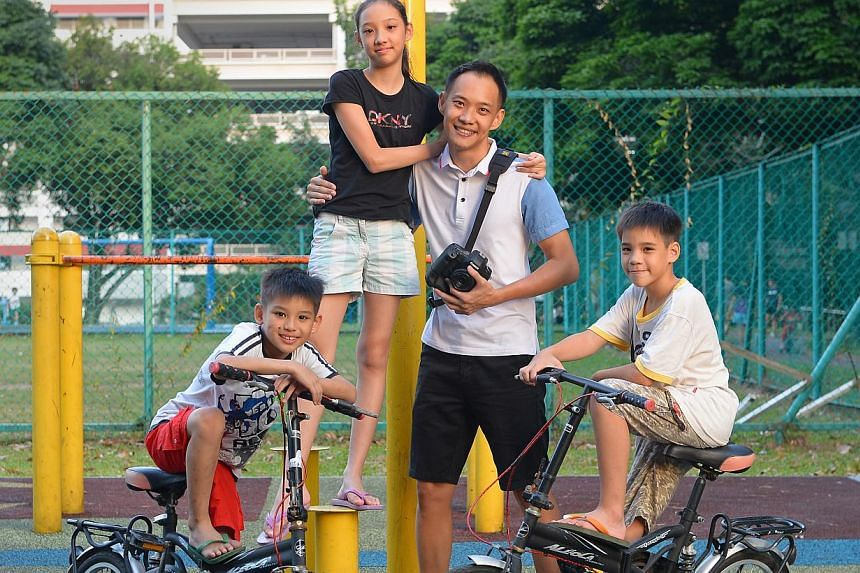 Welcome to Wayne's world: Mr Toh says his biggest challenge is meeting the individual wants and needs of his four children. Mr Wayne Toh with three of his four children (from left) Elliot, Ethel and Tertius. Mr Toh's life went into a harrowing spin w