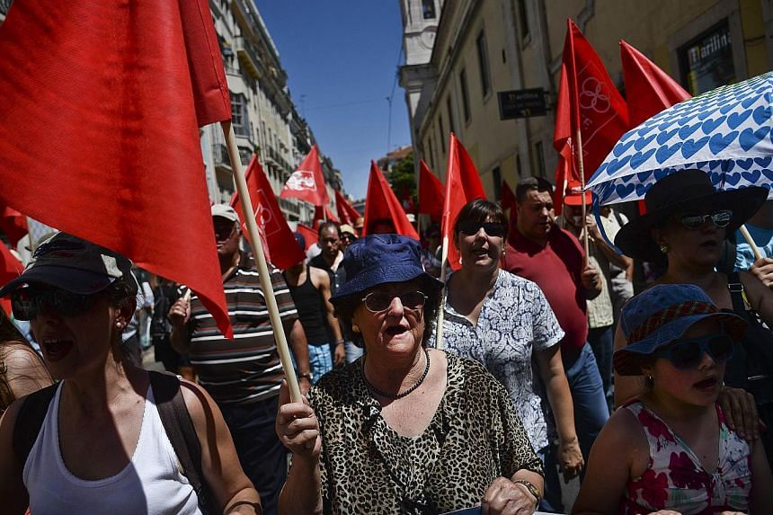 Demonstrators marching through Lisbon in protest against the austerity measures of the Portuguese government.