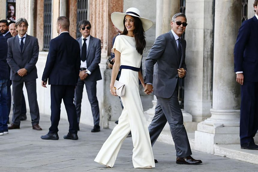 US actor George Clooney and British lawyer Amal Alamuddin arrive on Sept 29, 2014 at the palazzo Ca Farsetti in Venice, for a civil ceremony. -- PHOTO: AFP