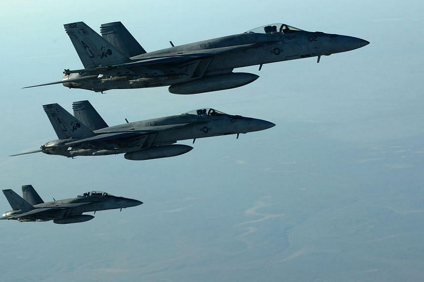 US war planes flying over northern Iraq on Sept 23, 2014. -- PHOTO: AFP