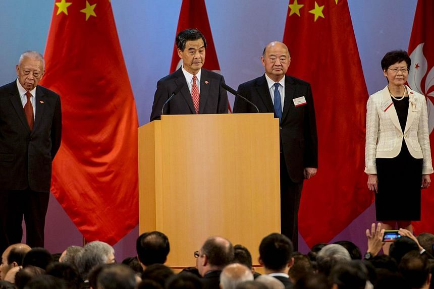 Hong Kong's Chief Executive Leung Chun Ying (centre) speaks at a reception to mark the 65th anniversary of the founding of Communist China in Hong Kong on Oct 1, 2014. -- PHOTO: AFP