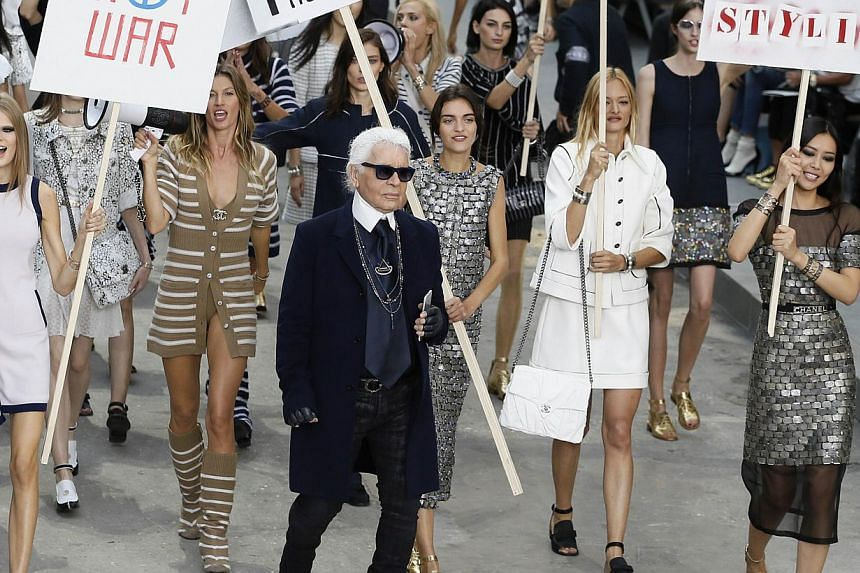 German fashion designer Karl Lagerfeld (centre) along with Brazilian model Gisele Bundchen (second from right) and other models at the end of the Chanel 2015 Spring/Summer ready-to-wear collection fashion show, at the Grand Palais in Paris on Sept 30