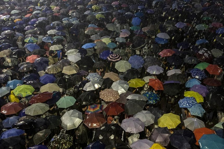A sea of umbrellas deployed by protesters during the heavy rain on Sept30, 2014. -- PHOTO:AFP