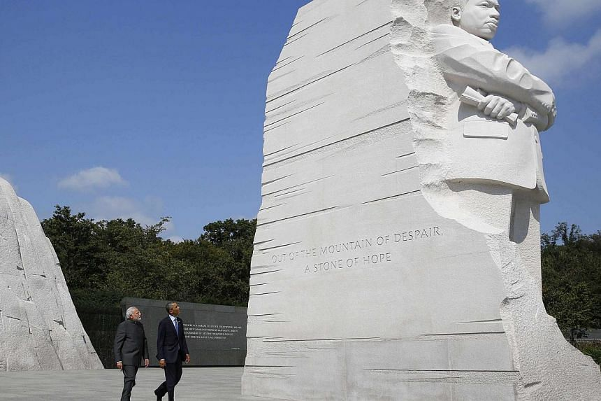 US President Barack Obama and India's Prime Minister Narendra Modi visit the National Martin Luther King Memorial on the National Mall in Washington on Sept 30, 2014. -- PHOTO: REUTERS