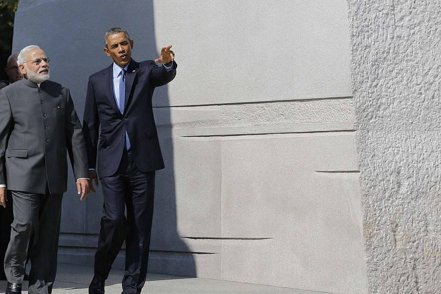 US President Barack Obama and India's Prime Minister Narendra Modi walk together at the National Martin Luther King Memorial on the National Mall in Washington on Sept 30, 2014. -- PHOTO: REUTERS