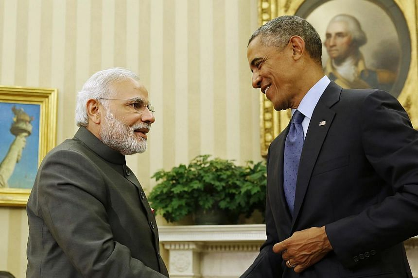 US President Barack Obama shakes hands with India's Prime Minister Narendra Modi at the end of their meeting in the Oval Office of the White House in Washington on Sept 30, 2014. -- PHOTO: REUTERS