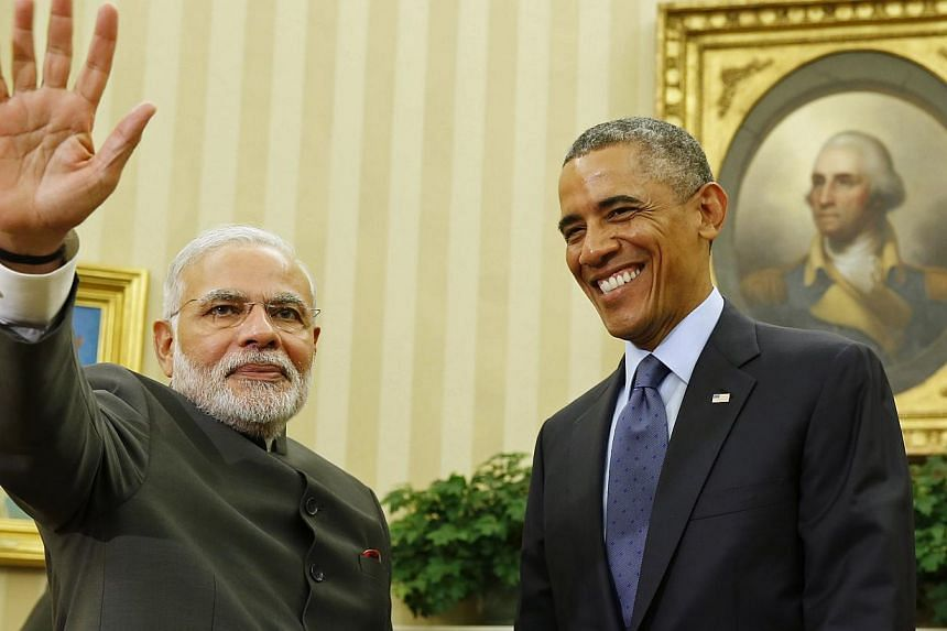 US President Barack Obama smiles as he hosts a meeting with India's Prime Minister Narendra Modi in the Oval Office of the White House in Washington on Sept 30, 2014. -- PHOTO: REUTERS
