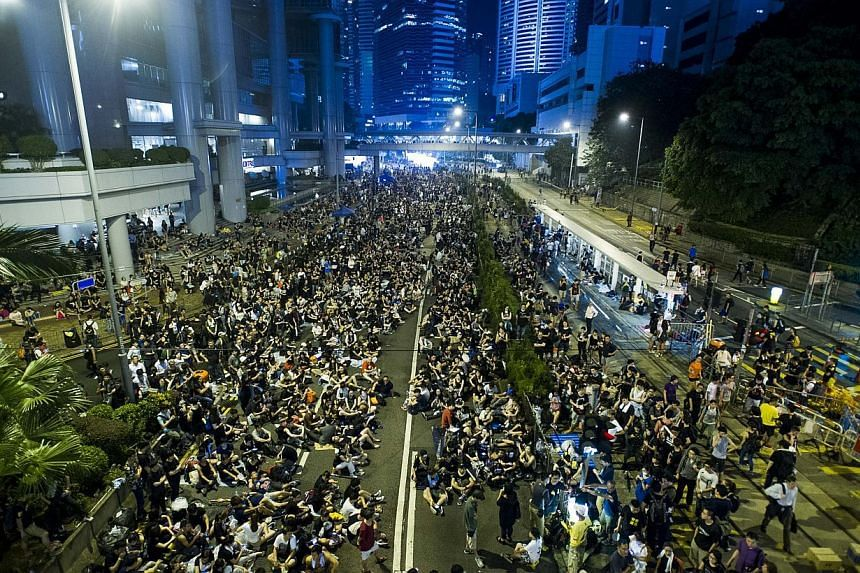 Pro-democracy demonstrators in the Admiralty district of Hong Kong on Oct 1, 2014. -- PHOTO: AFP