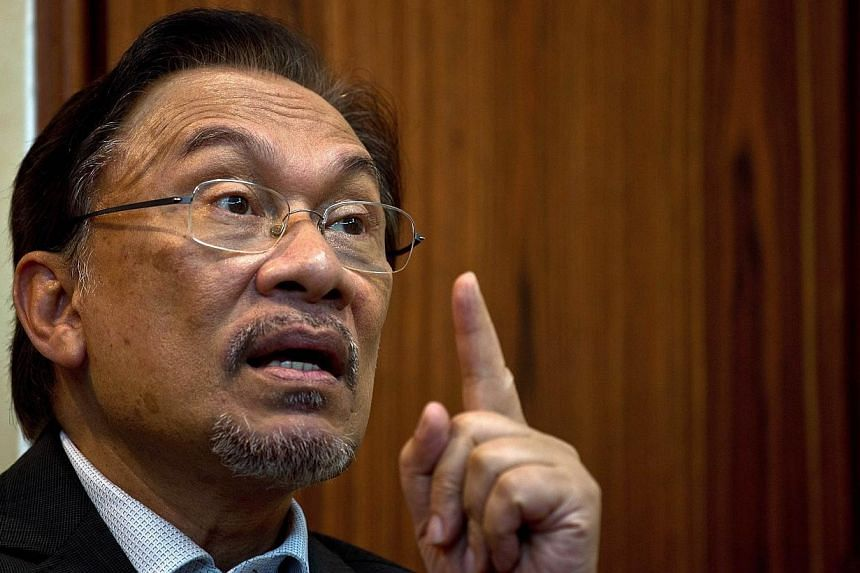 This file photo taken on April 9, 2014, shows Malaysian opposition leader Anwar Ibrahim speaking during an interview with AFP at his party office in Kuala Lumpur.Anwar was questioned last Friday over comments he made in a 2011 political speech,