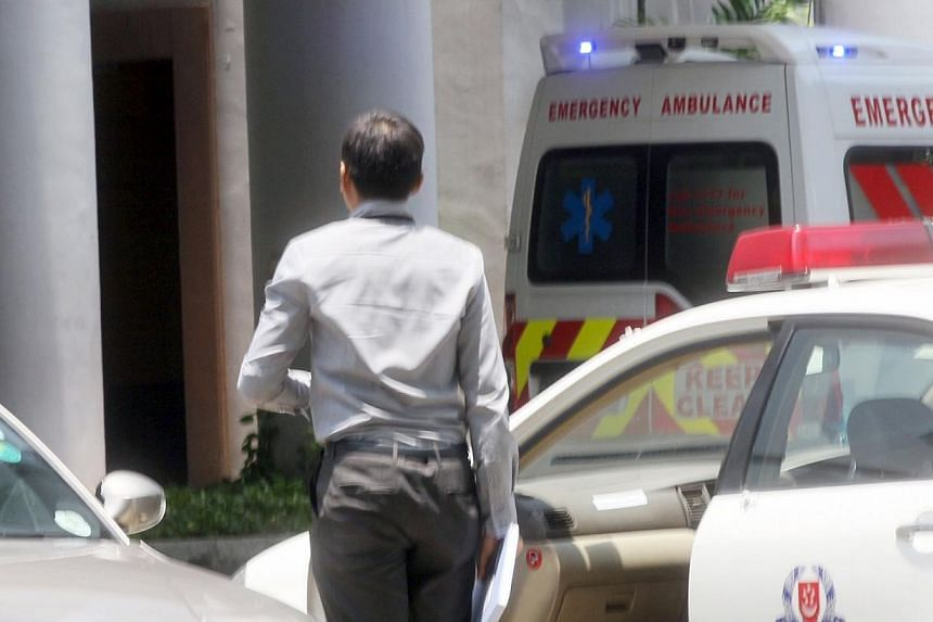 The decomposed bodies of two men, believed to be father and son, were found in a unit at The Bayshore condominium Wednesday morning, after neighbours complained of a foul smell. -- PHOTO: SHIN MIN