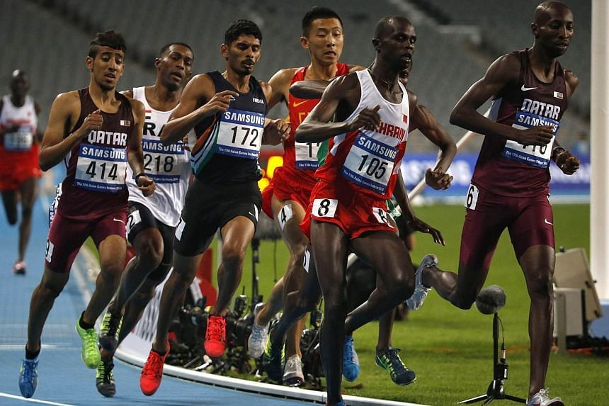 The pack races during the men's 800m final at the Incheon Asiad Main Stadium during the 17th Asian Games on Oct 1, 2014.All three top finishers in the men's 800 metres final were disqualified and an aggrieved Indian boxer turned down her bronze