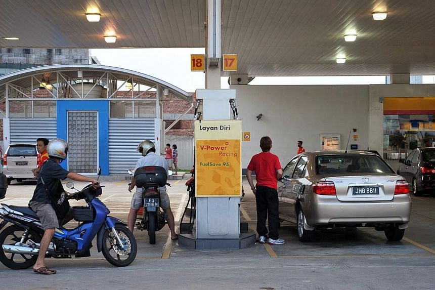 A Shell petrol station in Johor Bahru on 12 June 2011.Malaysia will raise prices of petrol and diesel by 20 sen (8 Singapore cents) from midnight on Wednesday. -- PHOTO: ST FILE