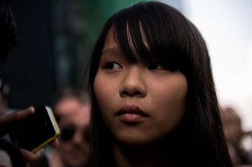 Student Agnes Chow listens to a question at a press conference on the next move for the pro-democracy protests that have gripped Hong Kong on Oct 1, 2014. -- PHOTO: AFP