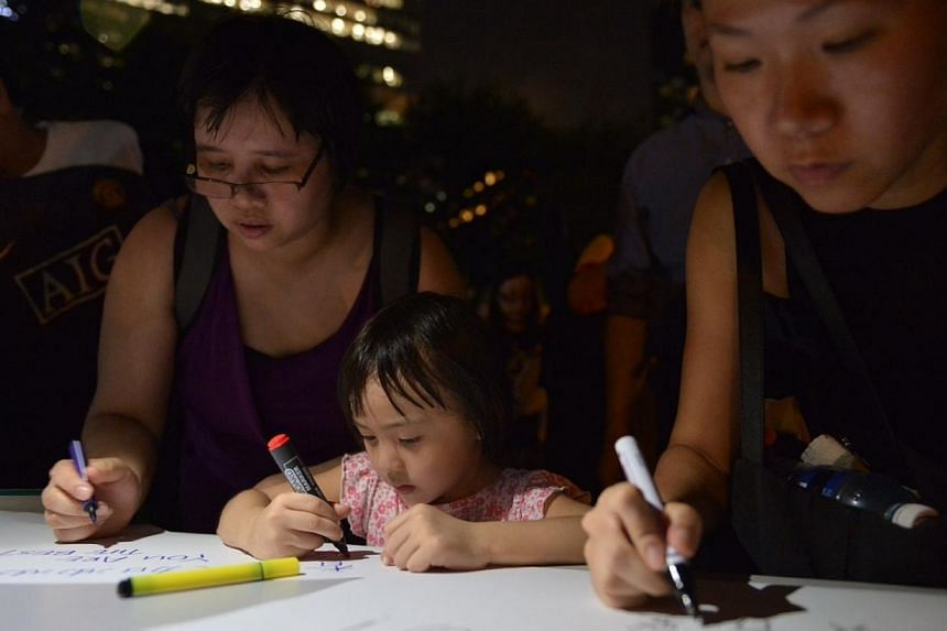 Singaporeans and foreigners gathered at Hong Lim Park on Wednesday night in a show of support for demonstrators in Hong Kong who are protesting against election restrictions. -- ST PHOTO: CAROLINE CHIA