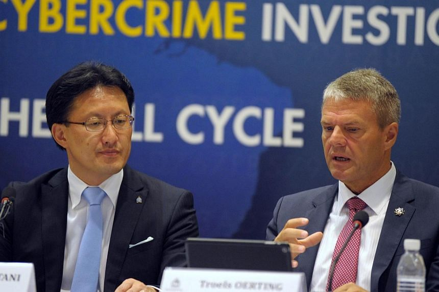 Assistant Director Head of EC3 Europol Troels Oerting (right) speaks next to Executive Director of Interpol Global Complex for Innovation (ICGI) Noboru Nakatani during the Interpol-Europol cybercrime conference at the Cantonment police headquaters in