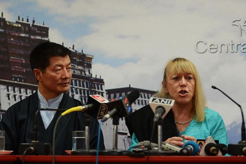 Nobel Peace Prize laureate Jody Williams (R) speaks as the Sikyong, or Prime Minister of the exiled administration, Lobsang Sangay looks on during a press conference to mark 25 years since the Dalai Lama was awarded the Nobel prize at the Central Tib