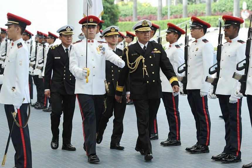 FADM Dato Aziz inspecting a Guard of Honour at Mindef. -- PHOTO: MINDEF