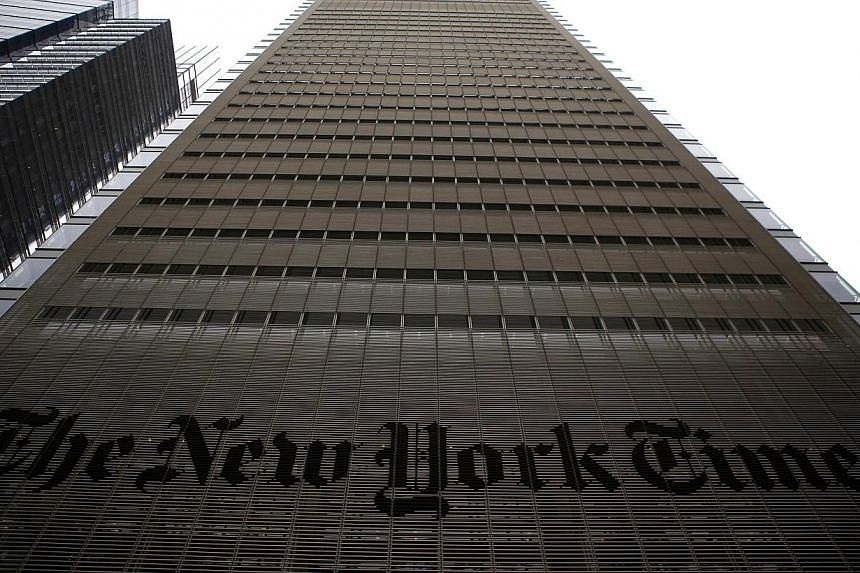 The New York Times building is seen in New York, in this file photo taken on Feb 7, 2013. The prestigious daily said Wednesday it plans to cut 100 newsroom jobs in the latest move to adapt to industry upheaval. -- PHOTO: REUTERS