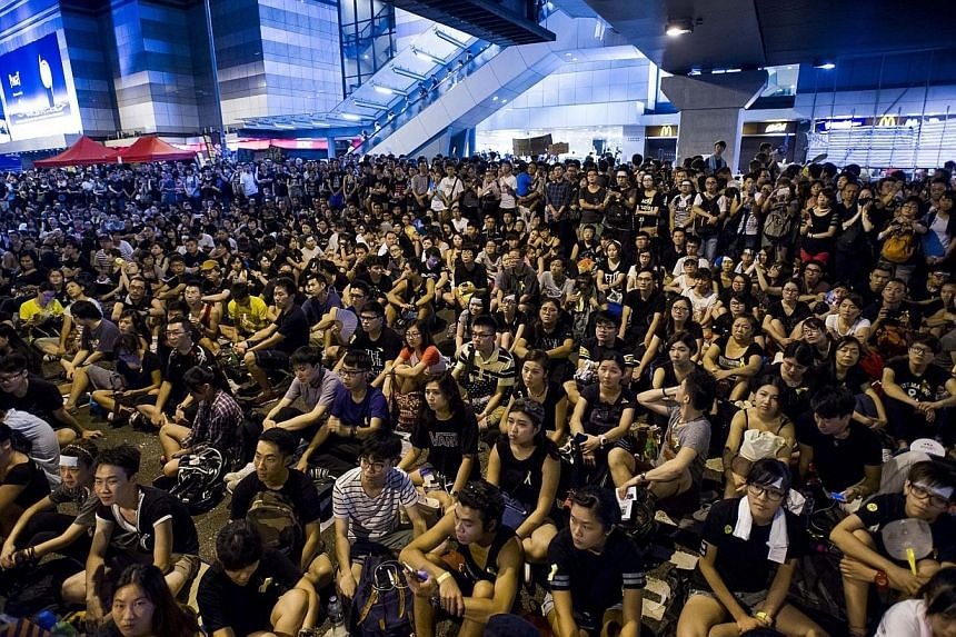 Pro-democracy protestors gather in the Admiralty district of Hong Kong on Oct 1, 2014. -- PHOTO: AFP