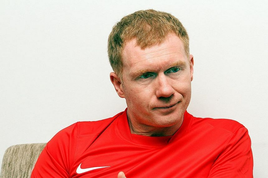 """Former Manchester United midfielder Paul Scholes at an exclusive meet-and-greet session held at Courts Megastore in Tampines on 22 March 2014.Former Manchester United star Paul Scholes slammed Manchester City's fans for failing to create a """"spe"""