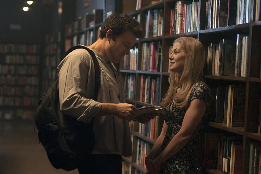 In Gone Girl, Ben Affleck and Rosamund Pike play a couple who appear to have a fairy-tale marriage, until she suddenly disappears. -- PHOTO: TWENTIETH CENTURY FOX