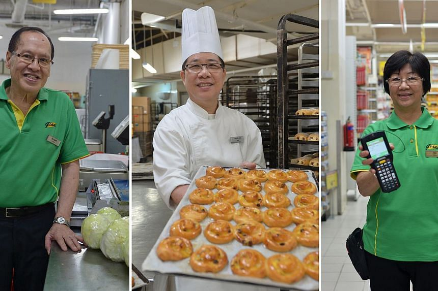 GOING STRONG AT GIANT: (From left) Mr Wong Kee Hua, 67, sorts and labels vegetables in Giant Hypermart at IMM; Mr Teoh Ah Kian, 62, is a baker; and Ms Teo Siam Sing, 65, is a sales assistant. Some older workers hope their employers will continue to o
