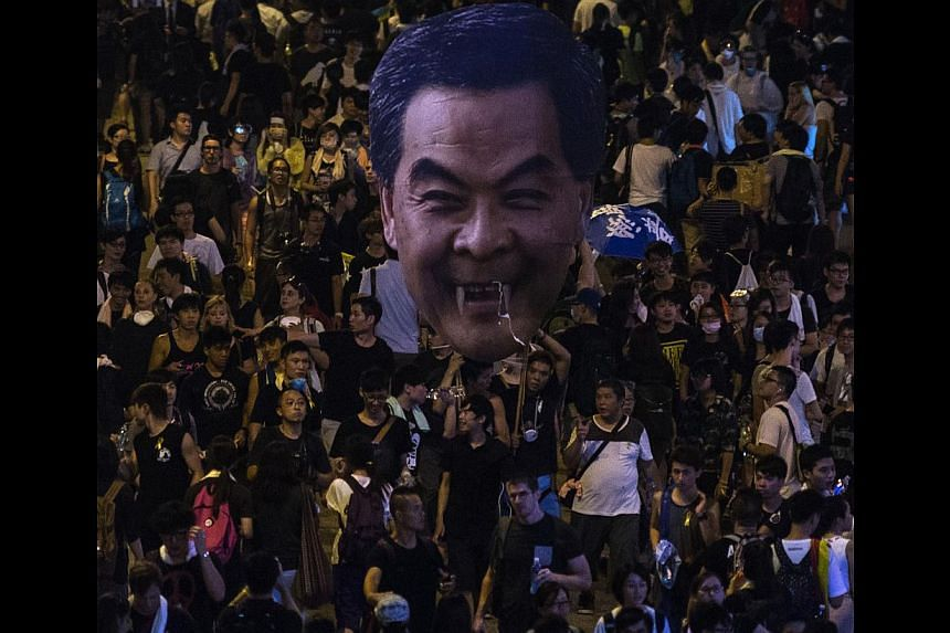 Hong Kong protesters with an effigy of Chief Executive Leung Chun Ying on Monday. Over the next few days, the world's eyes will be on the streets of Hong Kong and how the government of Beijing handles the crisis.