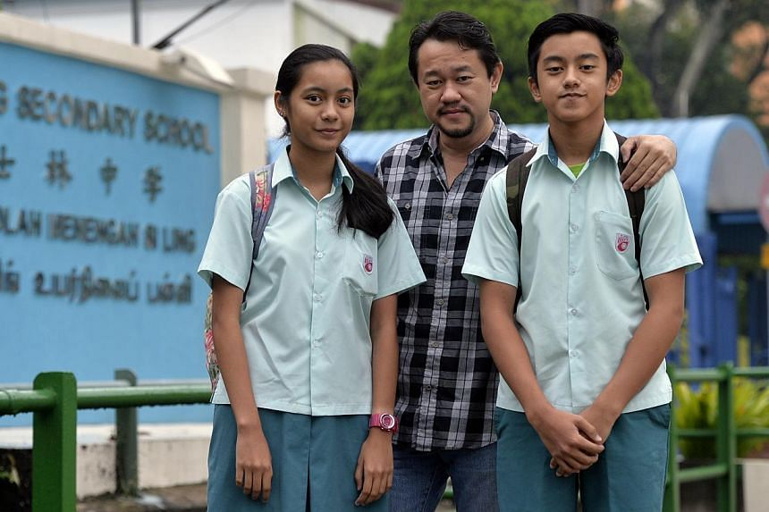 Singaporean Fahmi Rais, who lives in Johor Baru, drives across the Causeway to drop off three of his children at schools here - Siti Nur Natasya and Mikhael Rais at a secondary school and another daughter at the Institute of Technical Education. With