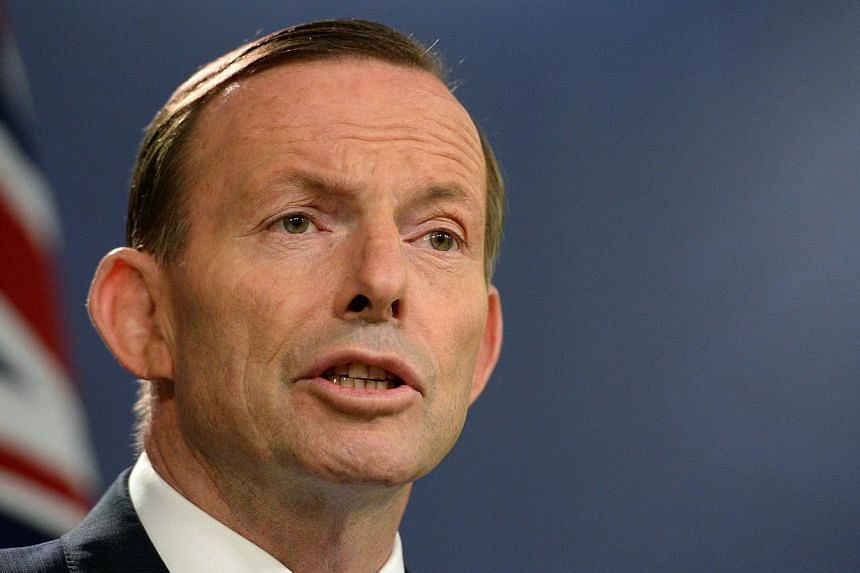 Australia's Prime Minister Tony Abbott speaks at a press conference in Sydney on Sept 19, 2014. -- PHOTO: AFP