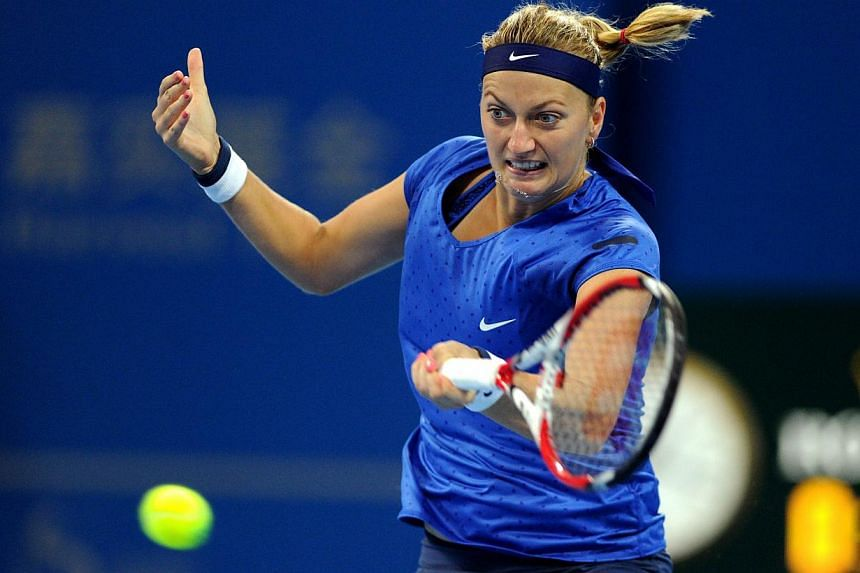 Petra Kvitova of Czekh returns a shot to Shuai Peng of China during their women's singles second round match at the China Open tennis tournament in the National Tennis Center of Beijing on Oct 1, 2014. -- PHOTO: AFP