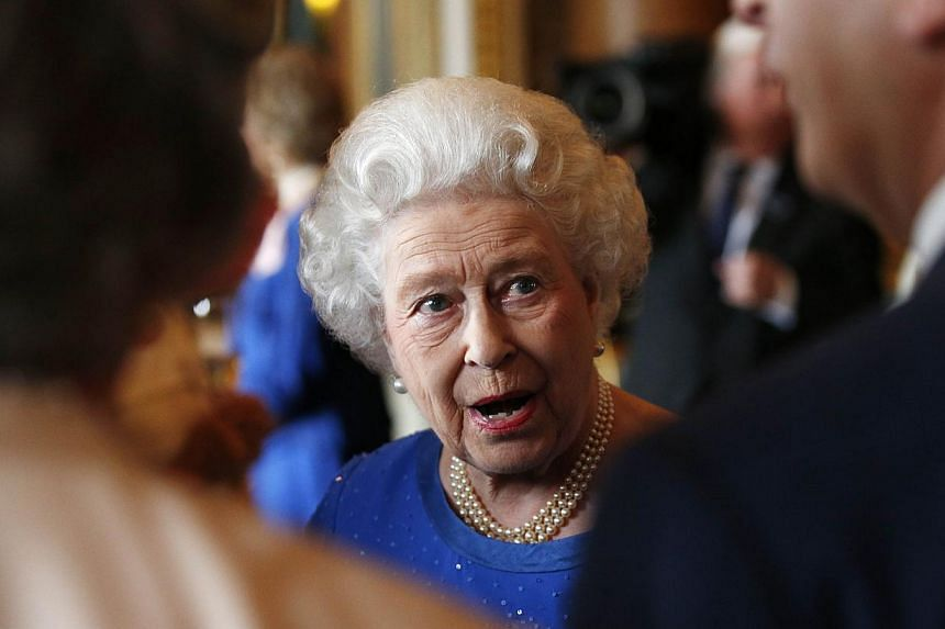 Britain's Queen Elizabeth II talks with guests at a reception at Buckingham Palace for winners of The Queen's Awards for Enterprise 2014 in London on July 14, 2014. -- PHOTO: AFP