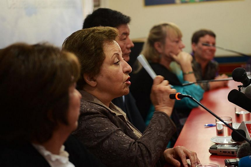 Nobel Peace Prize laureate Shirin Ebadi (centre) speaks during a press conference to mark 25 years since the Dalai Lama was awarded the Nobel prize at the Central Tibetan Administration in Dharamsala on Oct 1, 2014. -- PHOTO: AFP