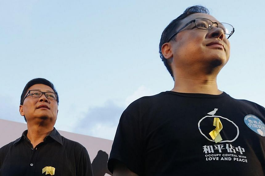 Academics Benny Tai (right) and Chan Kin Man, founders of the Occupy Central civil disobedience movement, attend a pro-democracy rally in Hong Kong on Aug 31, 2014. Chan struggled to contain his emotions on Wednesday as he warned that protests would