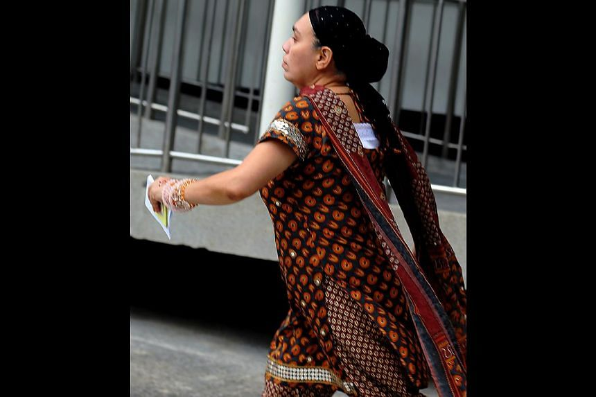 Satwant Kaur d/o Sardara Singh was charged in court on Wednesday with eight counts of misappropriating a total of $1.7 million from her former employer. -- ST PHOTO: WONG KWAI CHOW