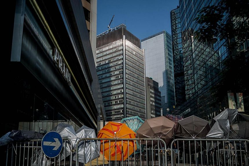 Umbrellas on a barricade set up by pro-democracy demonstrators in the Central district of Hong Kong on Sept30, 2014.-- PHOTO: REUTERS