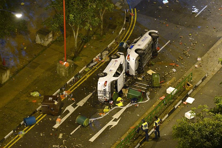 The overturned police cars in the aftermath of the Little India riot on Dec 9, 2013. -- ST FILE PHOTO: ALPHONSUS CHERN