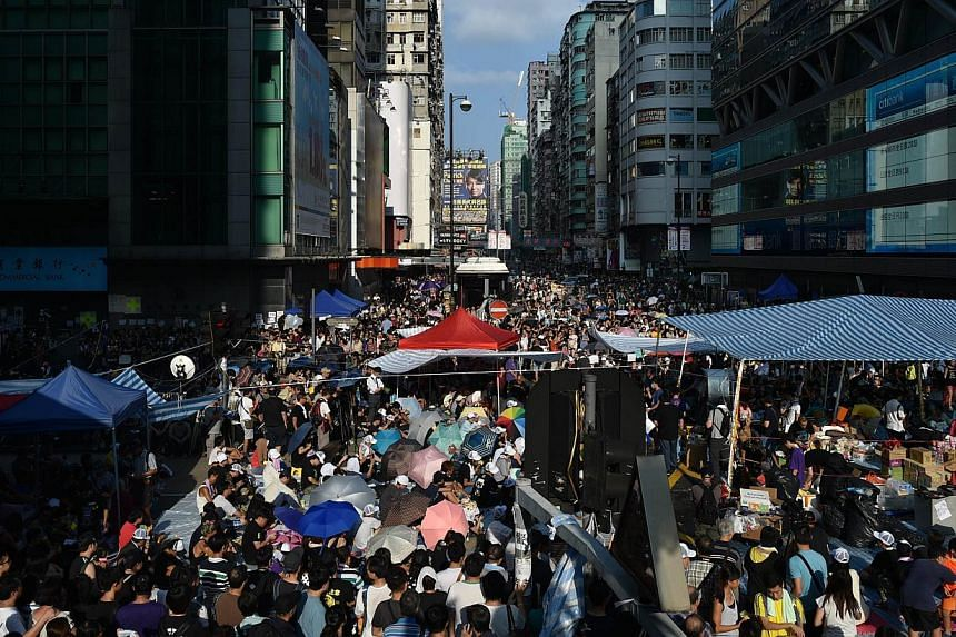 Pro-democracy protestors gather in the Mong Kok district of Kowloon in Hong Kong on Oct 1, 2014. -- PHOTO: AFP