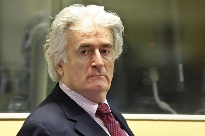 """A file photo on Nov 3, 2009 shows former Bosnian Serb leader Radovan Karadzic in the courtroom of the ICTY War Crimes tribunal in the Hague.Dr Karadzic """"did not know"""" of the 1995 massacre of thousands of Muslims at Srebrenica, his lawyer said o"""