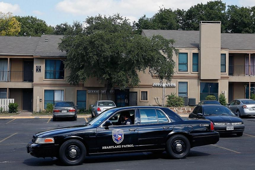 A private security guard patrols The Ivy Apartments, where the confirmed Ebola virus patient was staying on Oct 1, 2014 in Dallas, Texas.As many as 80 people were in contact with the Dallas Ebola patient at some point, Texas health officials to