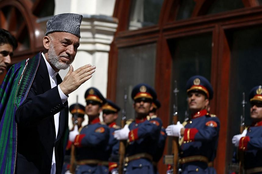 Former Afghanistan president Hamid Karzai arrives for the inauguration of the new president in Kabul on Sept 29, 2014.Mr Karzai may have brought development and relative stability to major cities, but an insurgency-wracked countryside and sky-high co
